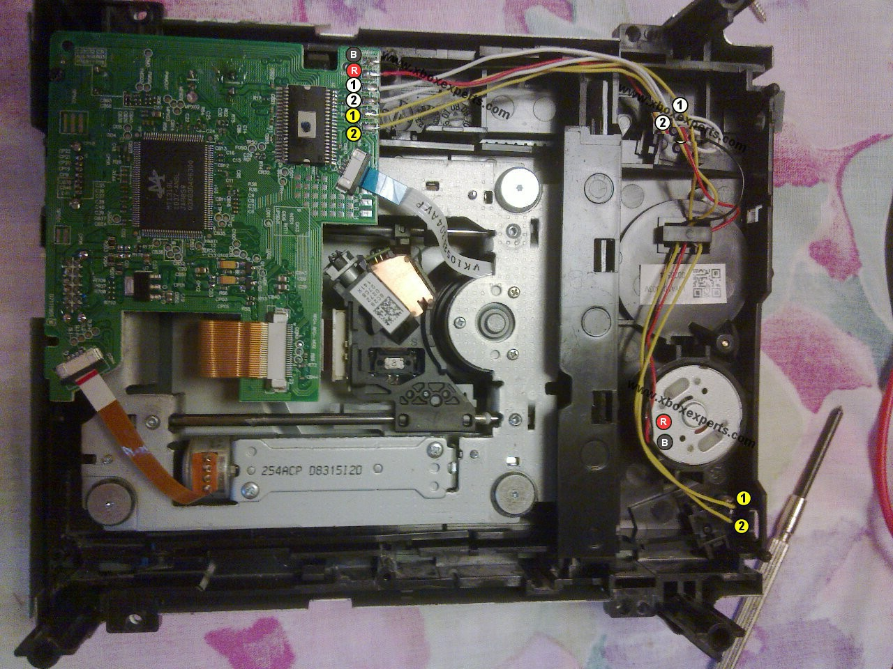 X ex tutorial swapping circuit boards of an xbox 360 dvd drive a pic 1 open up the dvd drives ccuart Choice Image
